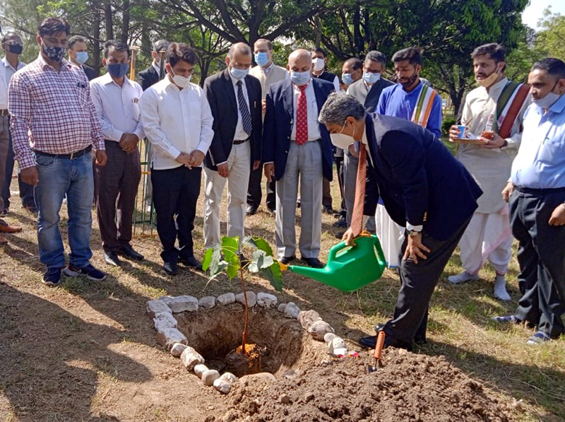 Chief Justice of J&K High Court Pankaj Mithal while planting a Peepal Sapling in the lawns of the High Court at Jammu.