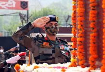 A senior Army officer paying tributes to martyrs to mark Rajouri Day.