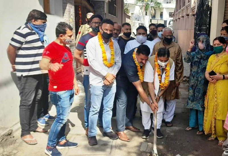 Former Minister Sat Sharma kick starting development works in Vikas Nagar on Wednesday.