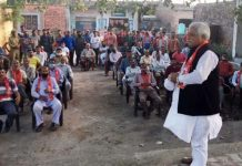 Senior NC leader Ajay Sadhotra addressing a public meeting at Kukerian in Marh area of Jammu.