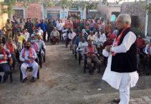 Senior NC leader Ajay Sadhotra addressing a public meeting at Kukerian in Marh area of Jammu.