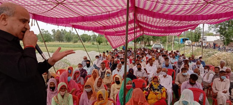 Former DyCM Tara Chand addressing public meeting in Pargwal area of Khour on Tuesday.
