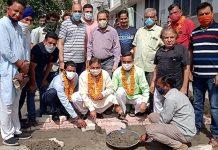 Former Minister, Sat Sharma kick starting construction of lane in Bohri on Sunday.
