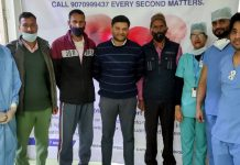 Dr Sushant Kumar, Senior Consultant Cardiologist at SMVD Narayana Hospital posing with his team.