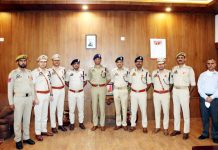 IGP Jammu Zone Mukesh Singh and recipients of JKPMG and JKPMMS posing for group photograph.