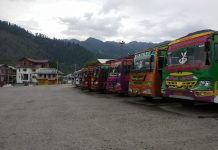 Buses remain parked at Bhaderwah Bus stand due to Corona curfew on Monday. -Excelsior/Tilak Raj