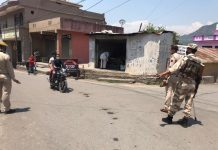 Security personnel stop bike riders during Corona curfew in Reasi on Monday. -Excelsior/Romesh Mengi