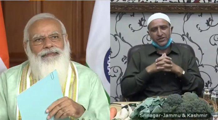 Prime Minister Narendra Modi inter-acting with Kashmiri farmer Khursheed Ahmad Reshi.