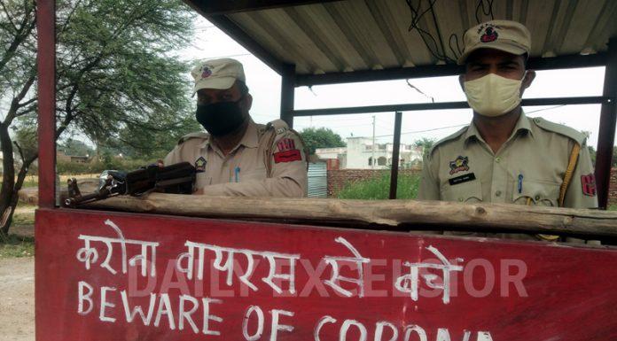 A warning sign outside a police bunker in Srinagar on Sunday. -Excelsior/Shakeel