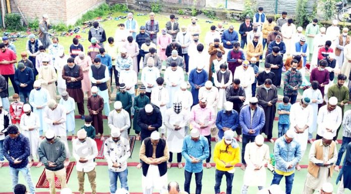People offer Eid-ul-Fitr prayer as they maintain social distancing in Srinagar on Thursday. -Excelsior/Shakeel