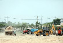 Men and machinery at work near Amarnath Yatri Niwas, Bhagwati Nagar in Jammu where DRDO is setting up a 500-bed hospital.— Excelsior/Rakesh