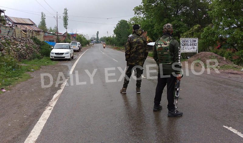 Troops at the site of encounter at Vailoo, Anantnag on Tuesday. -Excelsior/Sajad Dar