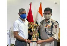 ADGP Mukesh Singh felicitating Inspector Rajesh Anand.
