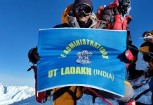 Jigmet Tharchin from Ladakh posing after summiting Mount Everest.