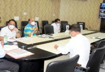 Div Com Jammu Raghav Langer chairing a meeting on Friday.