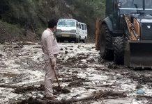 JCB removing landslide on highway at Doda. —Excelsior/Tilak Raj
