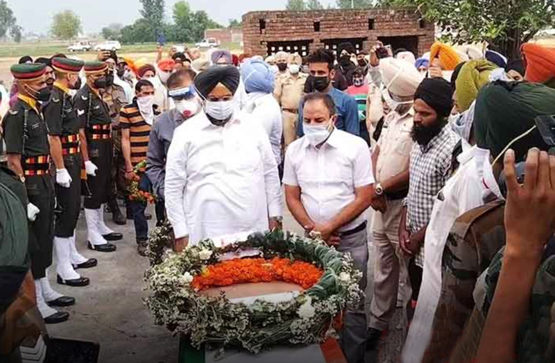 Mortal remains of Sepoy Pargat Singh being cremated with full military honour in village Daburji of Gurdaspur on Sunday.