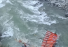 A view of submerged truck in fast-flowing stream near Ramsoo along Jammu-Srinagar National Highway. —Excelsior/Pervaiz