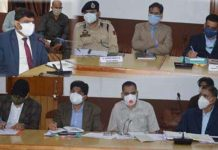 Divisional Commissioner Jammu Dr Raghav Langer chairing a meeting on Thursday.