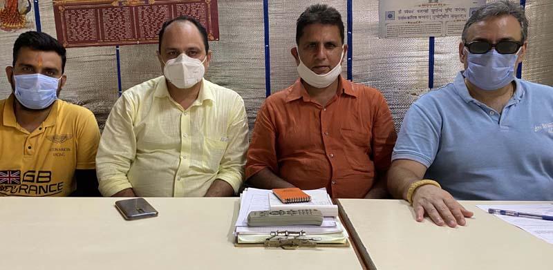 Members of Vishal Khatri Sabha J&K during a meeting at Jammu on Thursday.
