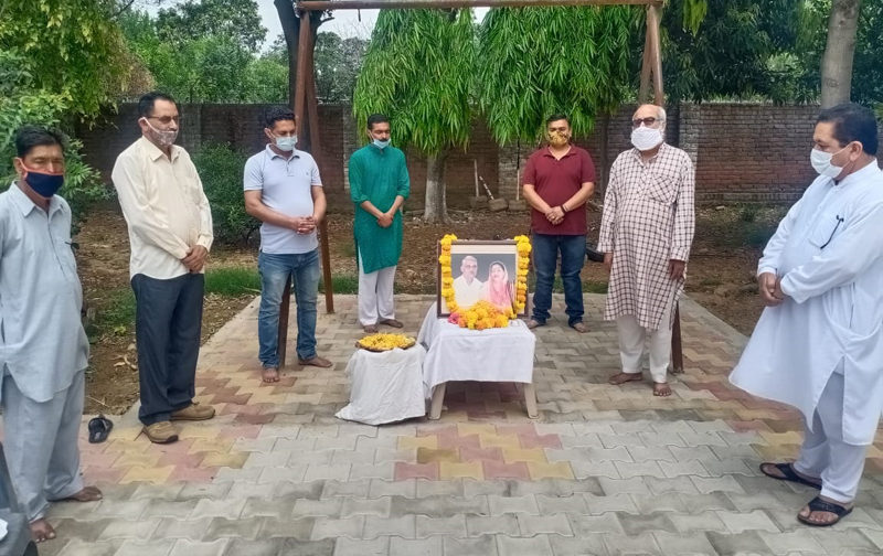 Floral tributes being paid to Hoshiyar Singh and his wife Shashi Bala on their 13th Martyrdom Day at Samba on Tuesday.