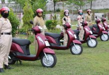 Women police officers of District Reasi posing for photograph after getting scooties.