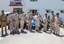ADGP Jammu Zone Mukesh Singh presenting keys of a scooty to woman police cop at district Rajouri on Saturday.