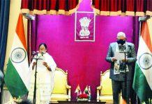 West Bengal Governor Jagdeep Dhankhar administers oath to TMC supremo Mamata Banerjee at Rajbhawan, in Kolkata.