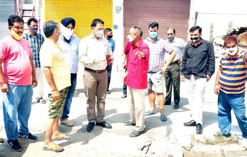 BJP leader Baldev Singh Billawaria interacting with people at Ward 56, Gandhi Nagar on Monday.