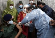 A senior police officer being vaccinated at special camp in Srinagar.