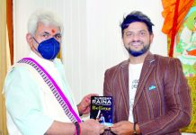 International Cricketer Suresh Raina presenting his book 'Believe' to LG Manoj Sinha at Srinagar.