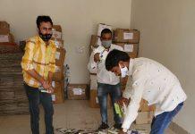 Officials destroying deceptive packing material in Kurukshetra.