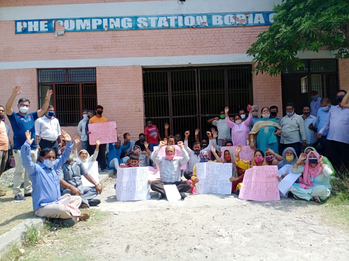 Protestors staging protest against PHE Department at Boria Pumping Station Bahu Fort on Monday.