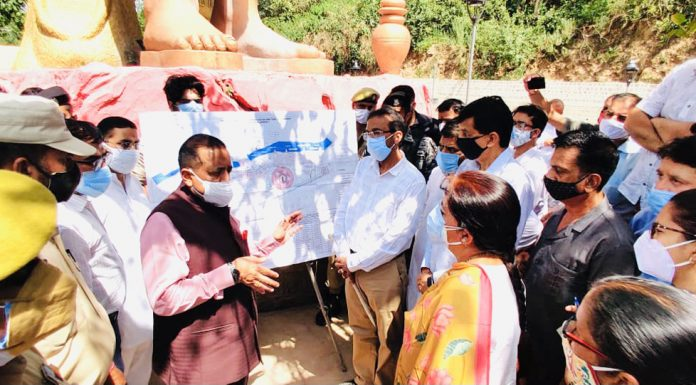 Union Minister Dr Jitendra Singh interacting with officers during his visit to Devika Project at Udhampur on Saturday.