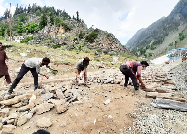 Repair works taking place on Pahalgam track to holy cave of Shri Amarnath Ji.