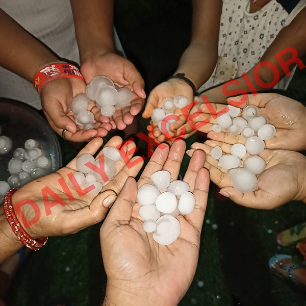 People show hailstones in their hands as Jammu was lashed by heavy rains and hailstorm on Thursday night. —Excelsior photo