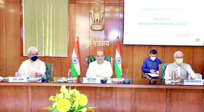 Home Minister Amit Shah and LG Manoj Sinha at high-level security review meeting in New Delhi on Friday.