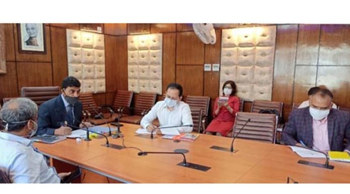 Chief Secretary Arun Kumar Mehta interacting with the DDC Chairpersons through video conferencing on Monday.