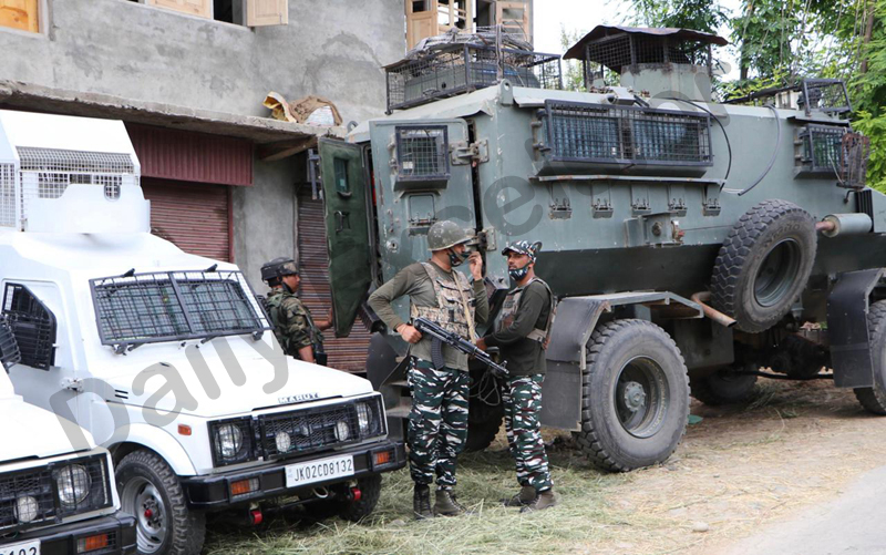 Security forces near encounter site at Shirmal in Shopian district on Wednesday. — Excelsior/Younis Khaliq