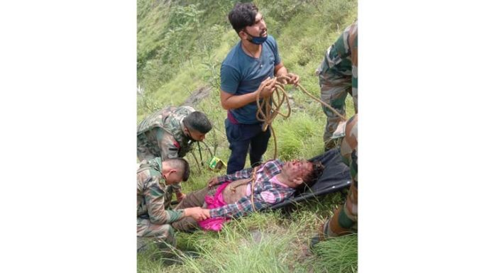 Army and police rescuing injured persons from accident site in Ramban district on Saturday. (UNI)