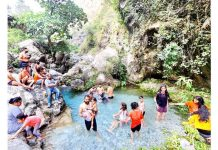 People beating the heat in a water stream near Katra on Wednesday. -Excelsior/Rakesh