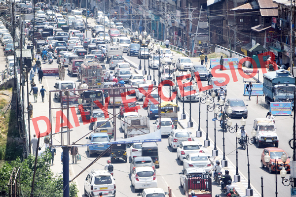 A view of traffic jam at Budshah bridge during relaxation in Srinagar on Monday. —Excelsior/Shakeel