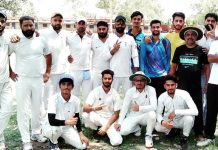 Players of winning team posing for group photograph at Akhnoor on Tuesday.