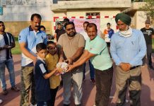 Officials of DYS&S distributing handballs among students in Udhampur.