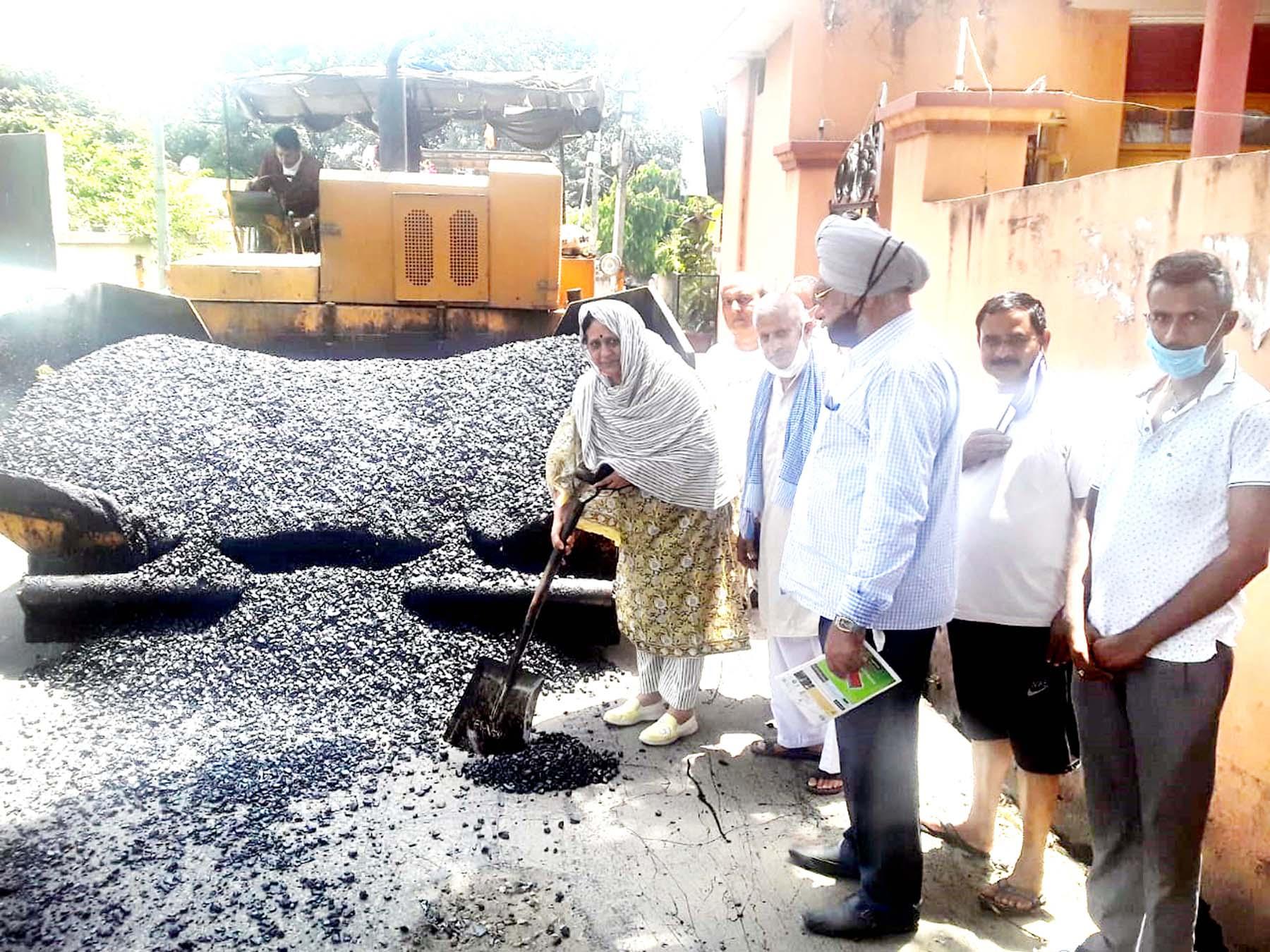 Councillor Rajni Bala starting blacktopping work in Ward 60 on Thursday.