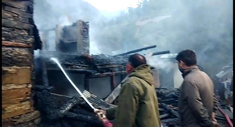 Fire fighters dousing flames. —Excelsior/Tilak Raj