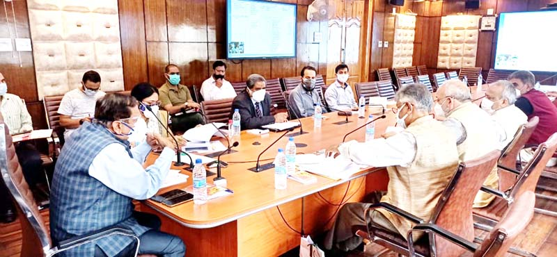 Advisor Rajeev Rai Bhatnagar chairing a meeting in Srinagar on Thursday.
