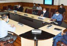 Chief Secretary Dr. Arun K Mehta chairing a meeting.