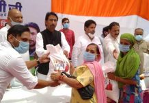 PCC chief G A Mir alongwith other Congress leaders distributing free ration among needy at RS Pura.