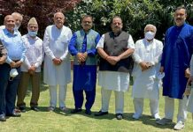 NC President Dr Farooq Abdullah and other party leaders posing for group photograph in Srinagar on Wednesday.